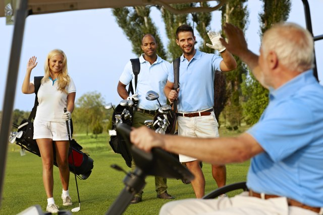 golfers smiling and waving