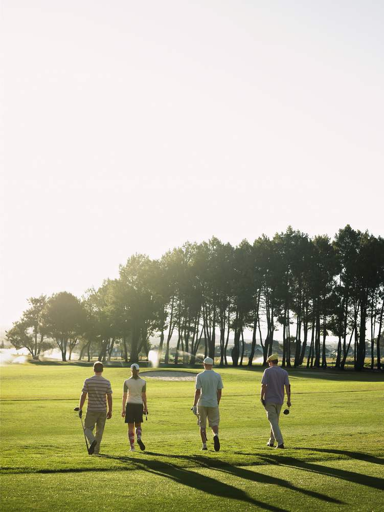 people-walking-across-golf-course