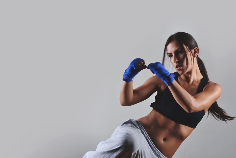 woman doing kickboxing in sportswear