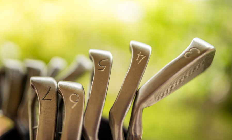Heads of golf irons in ascending order