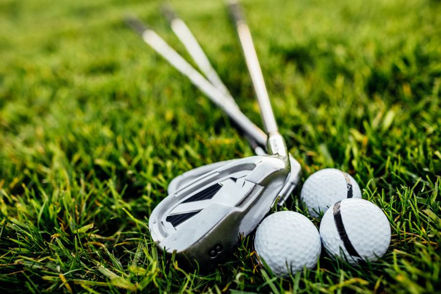 Steel or Graphite Shafts: Irons on the grass.